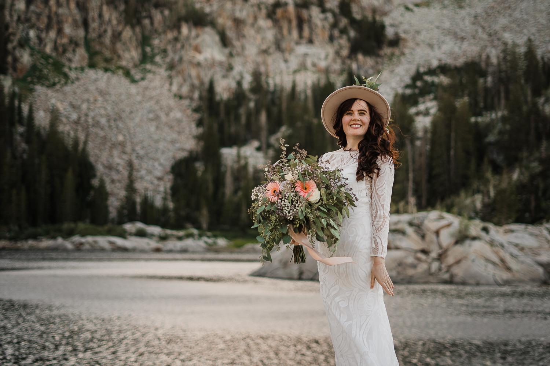 Boho long sleeve wedding dress greenery bouquet Lake Mary Salt Lake City Utah Alexandra Amante Forever To The Moon
